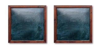 Marcos de madera vacíos en la pared Pizarras interiores y fondo blanco, espacio para el texto Fotos de archivo