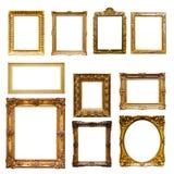 Marcos del oro Aislado en blanco Imagenes de archivo
