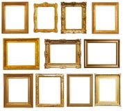 Marcos del oro Aislado sobre blanco Foto de archivo libre de regalías