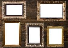 Marcos del oro viejo en la pared de madera Imágenes de archivo libres de regalías