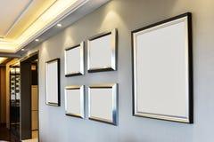 Marcos en blanco blancos en la pared Imagen de archivo libre de regalías