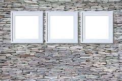 Marcos en blanco en la pared de piedra Imagenes de archivo