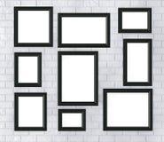 Marcos negros en una pared de ladrillo Fotos de archivo libres de regalías