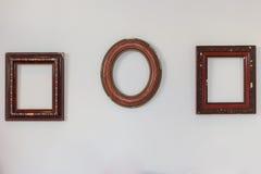 Marcos vacíos en la pared Imágenes de archivo libres de regalías