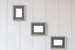 Marcos vacíos en la pared Fotos de archivo libres de regalías