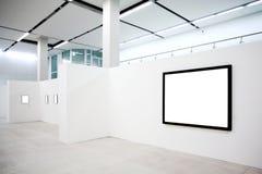 Marcos vacíos en la pared blanca Foto de archivo libre de regalías