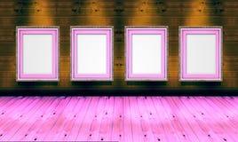 Marcos vacíos en la madera de la galería de arte Imagen de archivo libre de regalías