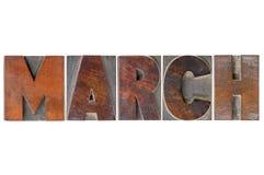 Marcowy miesiąc w drewnianym typ Zdjęcia Royalty Free