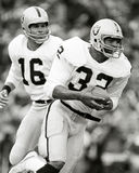 Marcus Allen. Oakland Raiders RB Marcus Allen takes a hand-off from QB Jim Plunkett.  (Image taken from b&w negative Stock Images