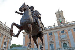 Marcus Aurelius at the Campidoglio in Rome, Italy. Equestrian statue of Marcus Aurelius in front of Palazzo Senatorio of Campidoglio on the Capitoline Hill, seat Royalty Free Stock Photo