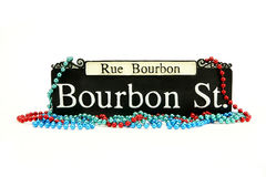 Mardi Gras. Bourbon Street Sign with beads Royalty Free Stock Photography