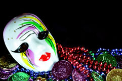Mardi Gras. Mask with beads and doubloons on black background with copy space Royalty Free Stock Photo