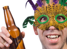 Mardi Gras. Closeup view of a partier holding his alcoholic beverage, isolated against a white background Stock Photography
