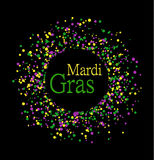 Mardi Gras abstract pattern made of colored dots on black background with colored words in center. Yellow, green and purple confet Stock Photos