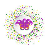 Mardi Gras abstract pattern made of colored dots on white background with colored clown mask in center.Yellow, green and purple co Stock Image