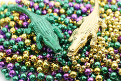 Mardi gras alligators. On a pile of beads Royalty Free Stock Photography