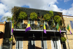 Mardi Gras Balcony. Balcony in the New Orleans French Quarter decorated for Mardi Gras Stock Photography