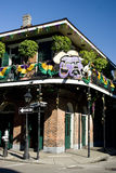Mardi Gras Balcony, Bourbon Street. Balcony in the New Orleans French Quarter on Bourbon Street decorated for Mardi Gras Stock Image