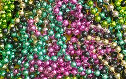 Mardi Gras bead color splash stock photo
