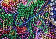 Mardi Gras Beads. Pile of Mardi Gras Beads ready to be tossed to parade audiences Royalty Free Stock Photo