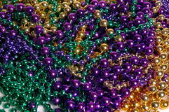 Mardi Gras Beads. From New Orleans in purple, gold and green piled up together