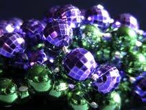 Mardi Gras Beads. Close up of purple and green Mardi Gras Beads Stock Photos