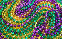 Mardi Gras beads background Stock Images