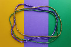 Mardi Gras beads background with place for text. Top view royalty free stock photos
