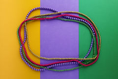 Mardi Gras beads background with place for text. Top view stock photo