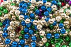 Mardi Gras Beads closeup Royalty Free Stock Images