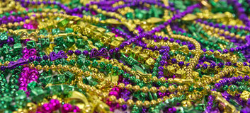 Mardi Gras Beads & Coins. Backgroun of colorful Mardi Gras beads