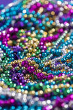 Mardi Gras beads with copy space Royalty Free Stock Photography
