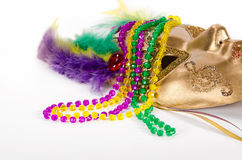 Mardi Gras beads and mask Stock Photography