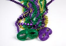 Mardi Gras Beads with Masks Stock Photo