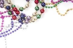 Mardi gras beads on white. Collection of colorful mardi gras beads royalty free stock photos