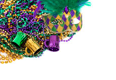 Mardi gras beads on a white background with copy space royalty free stock photos