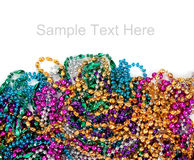 Mardi gras beads on white with copy space Stock Photos