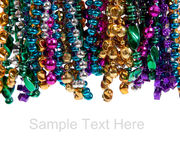 Mardi gras beads on white with copy space Royalty Free Stock Photos