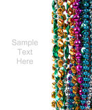 Mardi gras beads on white with copy space Stock Image