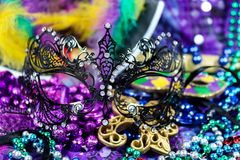 Mardi Gras Carnaval background - bright beautiful colors with mask and beads. A Mardi Gras Carnaval background - bright beautiful colors with mask and beads royalty free stock photos