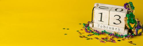 Mardi gras carnival background - beads and mask royalty free stock image
