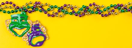 Mardi gras carnival background - beads and mask stock photos