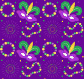 Mardi Gras Carnival seamless pattern with mask feathers, beads.   endless background, texture, wallpaper. Vector Stock Photography