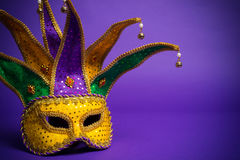 Mardi Gras or Carnivale mask on purple. Festive Grouping of mardi gras, venetian or carnivale mask on a purple background royalty free stock image