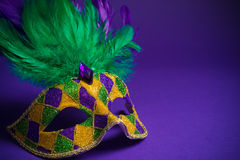 Mardi Gras or Carnivale mask on a purple background Stock Image