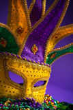 Mardi Gras or Carnivale mask on a purple background Royalty Free Stock Photography