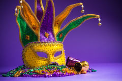 Mardi Gras or Carnivale mask on a purple background Stock Photography