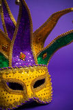 Mardi Gras or Carnivale mask on purple Royalty Free Stock Photos