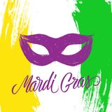 Mardi Gras celebrate card with calligraphic lettering text design, brush stroke background and carnival mask. Fat Tuesday vector illustration Stock Photo