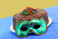 Mardi Gras Chocolate Doberge Cake with Mask Royalty Free Stock Image